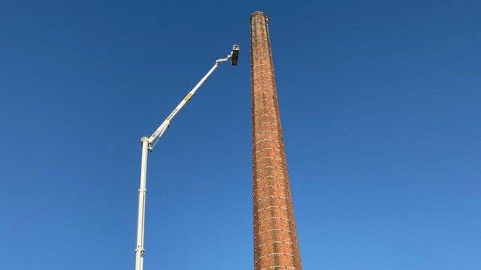 Carlisle Chimney man lowered finally.